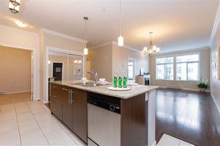Photo 3: 204 15388 101 Avenue in Surrey: Guildford Condo for sale (North Surrey)  : MLS®# R2334571