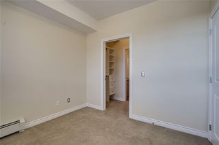 Photo 19: 451 26 VAL GARDENA View SW in Calgary: Springbank Hill Apartment for sale : MLS®# C4248066