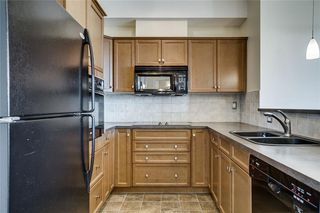 Photo 4: 451 26 VAL GARDENA View SW in Calgary: Springbank Hill Apartment for sale : MLS®# C4248066