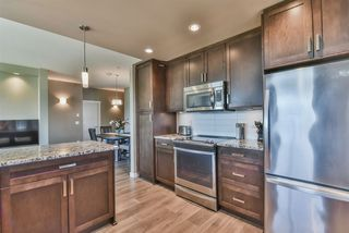 """Photo 2: 301 2242 WHATCOM Road in Abbotsford: Abbotsford East Condo for sale in """"Waterleaf"""" : MLS®# R2477896"""
