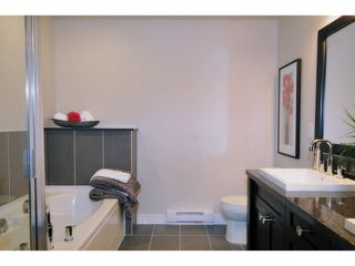 """Photo 14: 125 1480 SOUTHVIEW Street in Coquitlam: Burke Mountain Townhouse for sale in """"CEDAR CREEK"""" : MLS®# V1031684"""