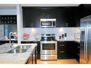 "Photo 3: 125 1480 SOUTHVIEW Street in Coquitlam: Burke Mountain Townhouse for sale in ""CEDAR CREEK"" : MLS®# V1031684"