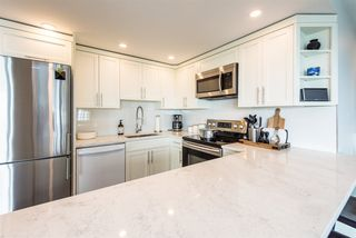 "Photo 18: 402 3920 HASTINGS Street in Burnaby: Willingdon Heights Condo for sale in ""INGLETON PLACE"" (Burnaby North)  : MLS®# R2298394"