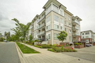 "Photo 1: 205 6468 195A Street in Surrey: Clayton Condo for sale in ""Yale Bloc Building 1"" (Cloverdale)  : MLS®# R2456985"
