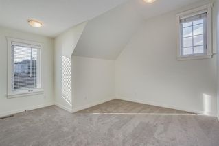 Photo 24: 219 Somme Manor SW in Calgary: Garrison Woods Detached for sale : MLS®# A1041747