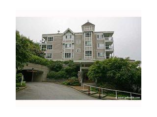 "Photo 1: 302 3033 TERRAVISTA Place in Port Moody: Port Moody Centre Condo for sale in ""Glenmore"" : MLS®# V1040400"