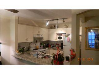 "Photo 2: 302 3033 TERRAVISTA Place in Port Moody: Port Moody Centre Condo for sale in ""Glenmore"" : MLS®# V1040400"
