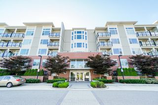 "Photo 3: 113 15956 86A Avenue in Surrey: Fleetwood Tynehead Condo for sale in ""ASCEND"" : MLS®# R2302925"