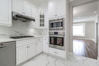 Photo 2: 4363 HURST Street in Burnaby: Metrotown House 1/2 Duplex for sale (Burnaby South)  : MLS®# R2325354