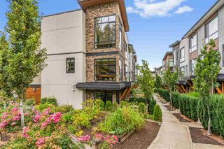 """Photo 2: 102 16488 64 Avenue in Surrey: Cloverdale BC Townhouse for sale in """"HARVEST AT BOSE FARMS"""" (Cloverdale)  : MLS®# R2489830"""
