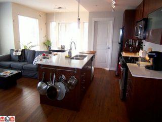 Photo 3: 204 13339 102A Avenue in Surrey: Whalley Condo for sale : MLS®# F1102960