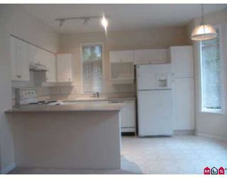 """Photo 2: 6950 120TH Street in Surrey: West Newton Townhouse for sale in """"COUGAR CR."""" : MLS®# F2619531"""