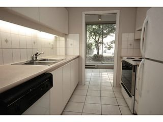"""Photo 7: 101 2638 ASH Street in Vancouver: Fairview VW Condo for sale in """"CAMBRIDGE GARDENS"""" (Vancouver West)  : MLS®# V1137698"""