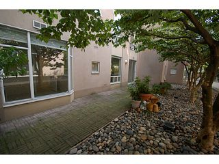 """Photo 11: 101 2638 ASH Street in Vancouver: Fairview VW Condo for sale in """"CAMBRIDGE GARDENS"""" (Vancouver West)  : MLS®# V1137698"""