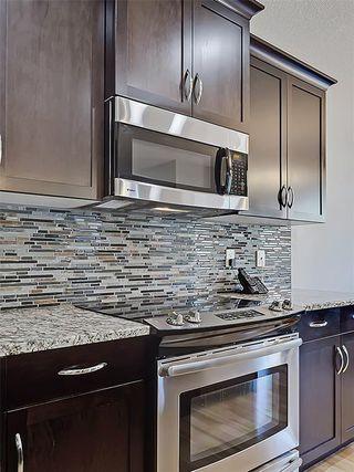 Photo 8: 353 SILVERADO Boulevard SW in Calgary: Silverado House for sale : MLS®# C4125629