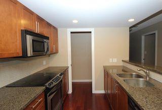 """Photo 5: 404 288 UNGLESS Way in Port Moody: North Shore Pt Moody Condo for sale in """"CRESCENDO"""" : MLS®# R2218295"""