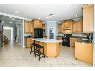 """Photo 6: 6315 166 Street in Surrey: Cloverdale BC House for sale in """"Clover Ridge"""" (Cloverdale)  : MLS®# R2332477"""