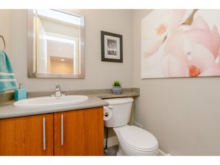 """Photo 12: 65 7088 191 Street in Surrey: Clayton Townhouse for sale in """"Montana"""" (Cloverdale)  : MLS®# R2357208"""