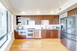 "Photo 1: 204 14300 RIVERPORT Way in Richmond: East Richmond Condo for sale in ""Waterstone Pier"" : MLS®# R2376463"