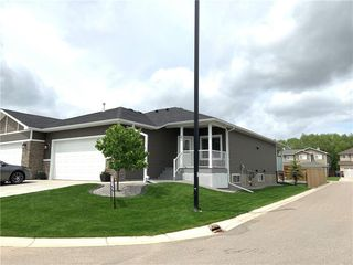 Photo 1: 2 Stone Garden Crescent: Carstairs Semi Detached for sale : MLS®# C4293584