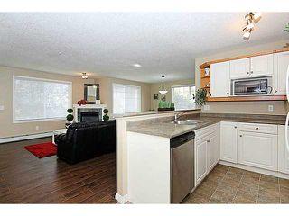 Photo 7: 103 15320 BANNISTER Road SE in CALGARY: Midnapore Condo for sale (Calgary)  : MLS®# C3587093