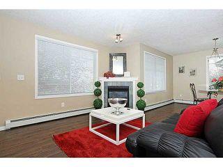 Photo 8: 103 15320 BANNISTER Road SE in CALGARY: Midnapore Condo for sale (Calgary)  : MLS®# C3587093