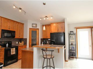 Photo 7: 779 STONEHAVEN Drive: Carstairs Residential Detached Single Family for sale : MLS®# C3617481
