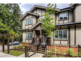 Photo 2: 117 3333 DEWDNEY TRUNK Road in Port Moody: Port Moody Centre Home for sale ()  : MLS®# V1003895