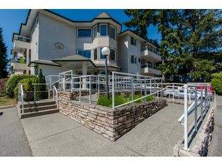 "Photo 1: 106 3063 IMMEL Street in Abbotsford: Central Abbotsford Condo for sale in ""Clayburn Ridge"" : MLS®# R2068519"