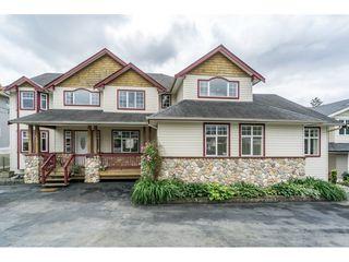 "Photo 1: 638 THOMPSON Avenue in Coquitlam: Coquitlam West House for sale in ""Burquitlam"" : MLS®# R2071441"