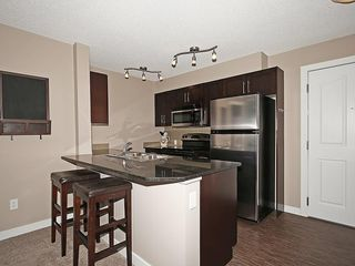 Photo 5: 2211 403 MACKENZIE Way SW: Airdrie Condo for sale : MLS®# C4115283