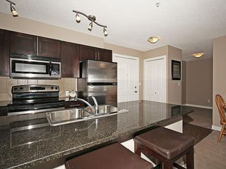Photo 6: 2211 403 MACKENZIE Way SW: Airdrie Condo for sale : MLS®# C4115283