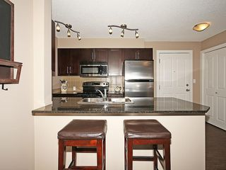 Photo 8: 2211 403 MACKENZIE Way SW: Airdrie Condo for sale : MLS®# C4115283