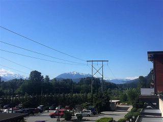 """Photo 2: 201 40437 TANTALUS Road in Squamish: Garibaldi Estates Condo for sale in """"Spectacle"""" : MLS®# R2186040"""