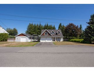 "Photo 1: 5718 245A Street in Langley: Salmon River House for sale in ""STRAWBERRY HILL"" : MLS®# R2291710"