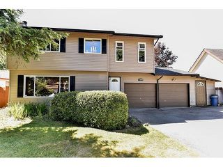 Photo 1: 15484 MADRONA Drive in Surrey: King George Corridor House for sale (South Surrey White Rock)  : MLS®# F1443553
