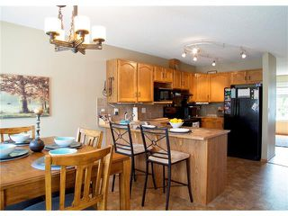 Photo 3: 8 105 ELM Place: Okotoks House for sale : MLS®# C4024142