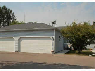 Photo 1: 8 105 ELM Place: Okotoks House for sale : MLS®# C4024142