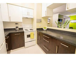 """Photo 8: 111 1545 E 2ND Avenue in Vancouver: Grandview VE Condo for sale in """"TALISHAN WOODS"""" (Vancouver East)  : MLS®# V1140826"""