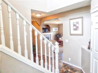Photo 8: 1010 BRIDLEMEADOWS Manor SW in Calgary: Bridlewood House for sale : MLS®# C4065914