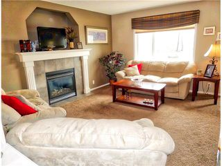 Photo 11: 1010 BRIDLEMEADOWS Manor SW in Calgary: Bridlewood House for sale : MLS®# C4065914