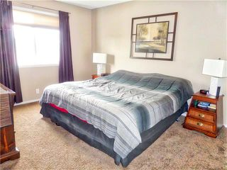 Photo 27: 1010 BRIDLEMEADOWS Manor SW in Calgary: Bridlewood House for sale : MLS®# C4065914