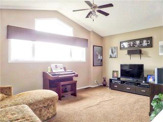 Photo 22: 1010 BRIDLEMEADOWS Manor SW in Calgary: Bridlewood House for sale : MLS®# C4065914
