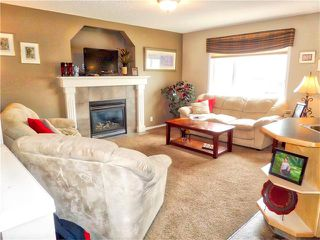 Photo 9: 1010 BRIDLEMEADOWS Manor SW in Calgary: Bridlewood House for sale : MLS®# C4065914