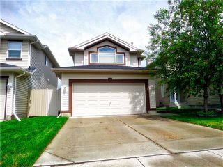 Photo 2: 1010 BRIDLEMEADOWS Manor SW in Calgary: Bridlewood House for sale : MLS®# C4065914