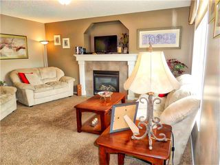 Photo 10: 1010 BRIDLEMEADOWS Manor SW in Calgary: Bridlewood House for sale : MLS®# C4065914