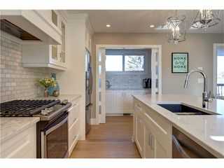 Photo 12: 179 WINDERMERE Road SW in Calgary: Wildwood House for sale : MLS®# C4103216