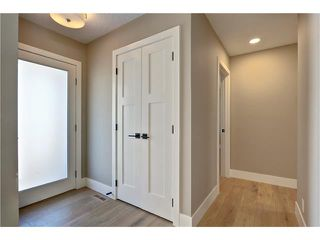 Photo 2: 179 WINDERMERE Road SW in Calgary: Wildwood House for sale : MLS®# C4103216
