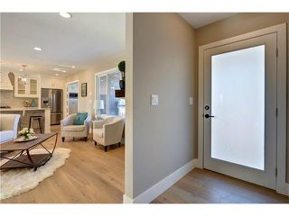 Photo 3: 179 WINDERMERE Road SW in Calgary: Wildwood House for sale : MLS®# C4103216