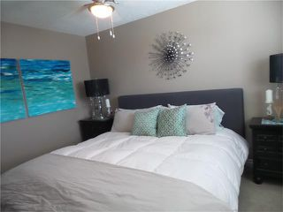 Photo 9: 97 CRYSTAL SHORES Cove: Okotoks House for sale : MLS®# C4113551